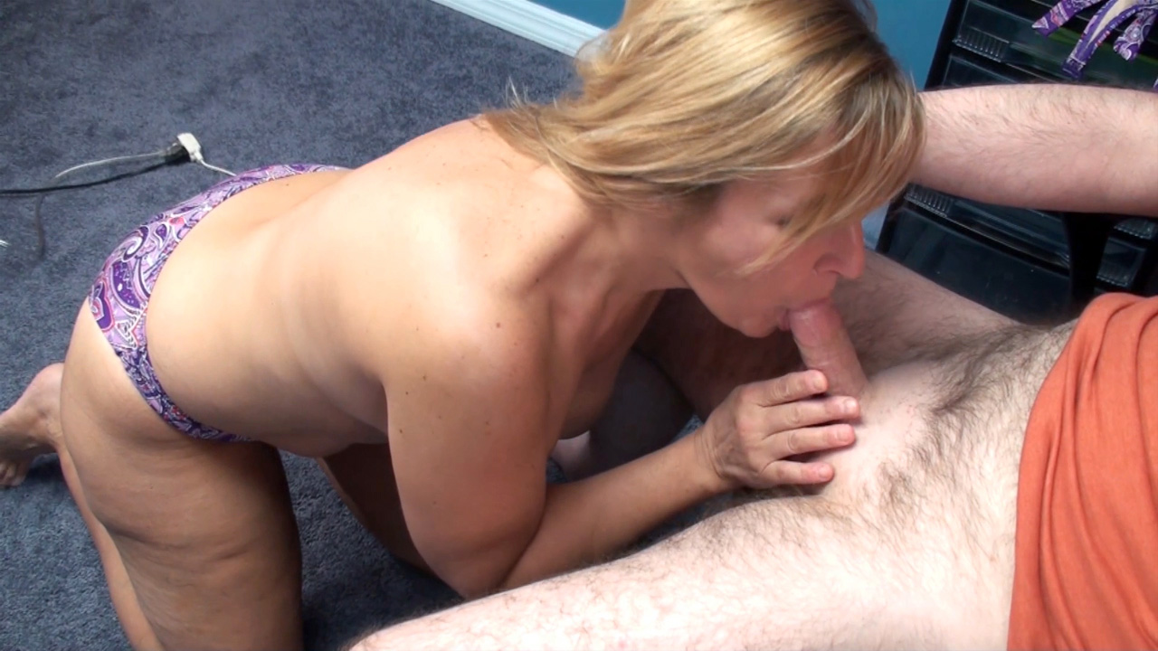 Naked mature sucks cock on her knees